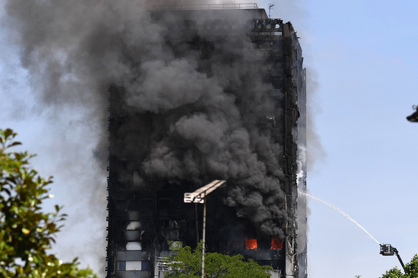 May blames councils over non-compliant cladding