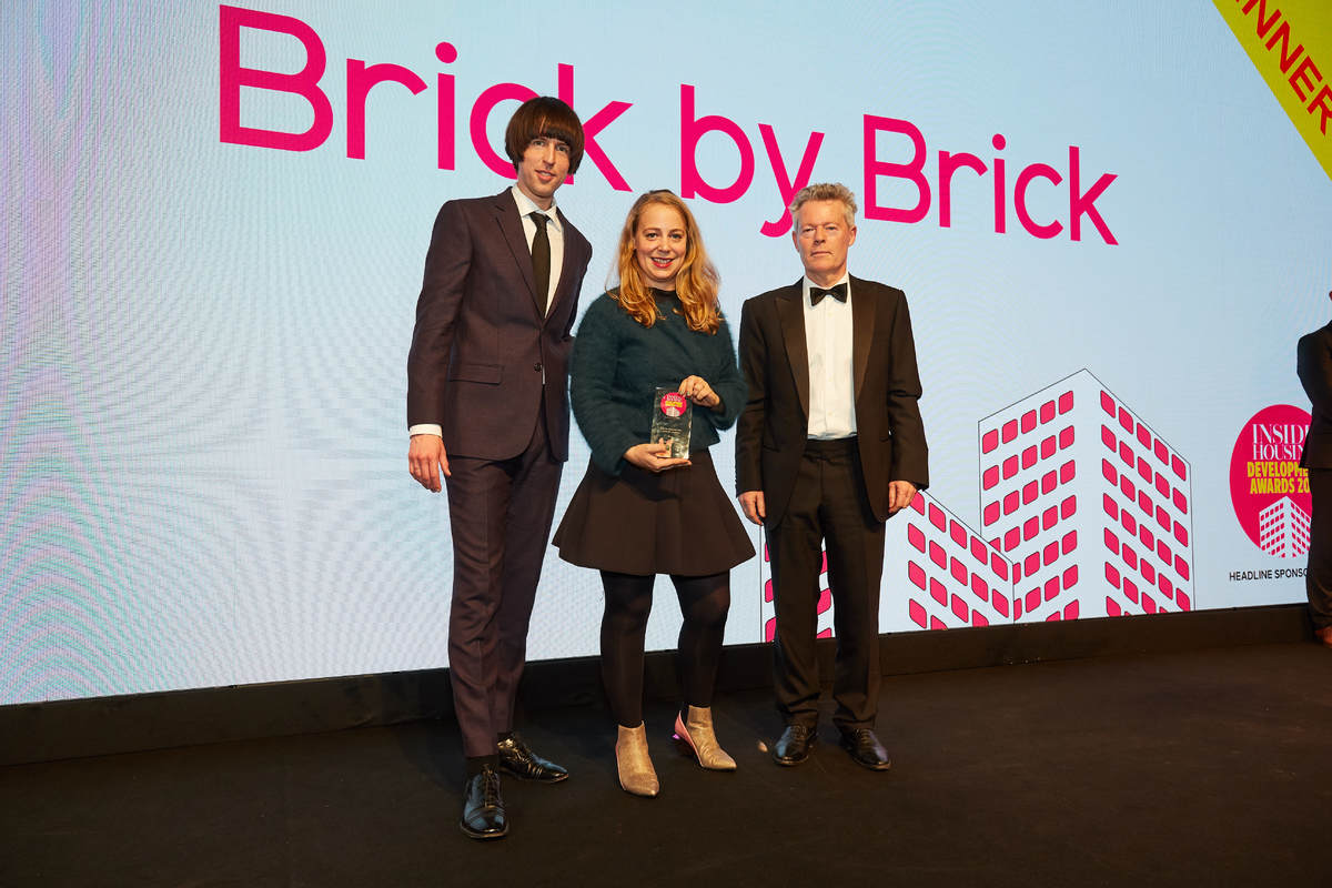 Chloe Phelps picking up an award at the Inside Housing Development Awards