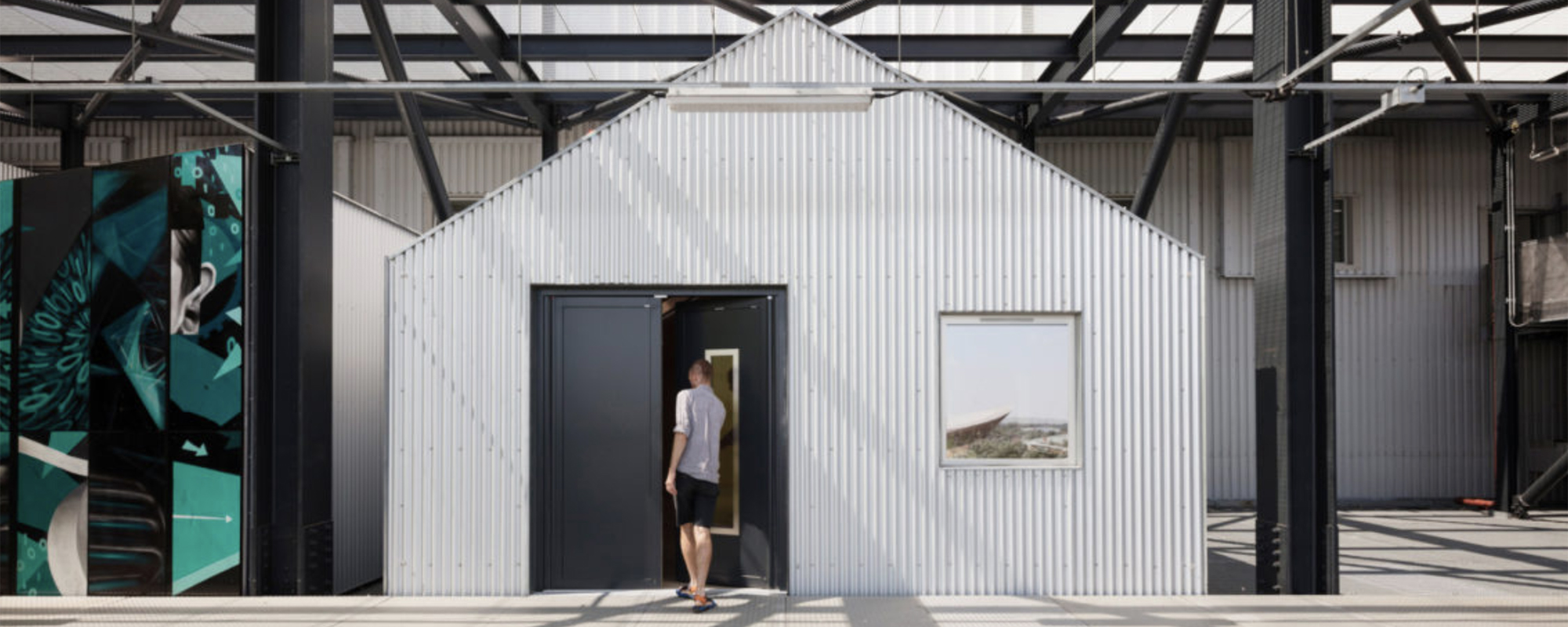 Small studio huts were included to attract businesses pushed out of Hackney Wick