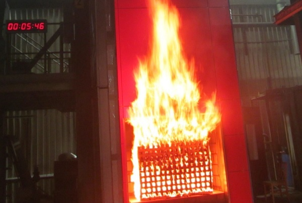 An HPL cladding system five minutes into a fire test (picture: BRE)