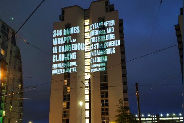 The NV Building illuminated with a message about cladding (pictue: Grenfell United)