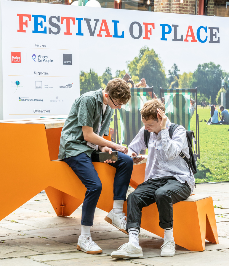 Festival of Place 2019 attendees reading the programme
