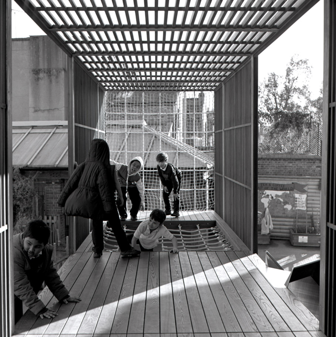 Children playing in the Chisenhill raised platform designed by architect and school parent Asif Khan
