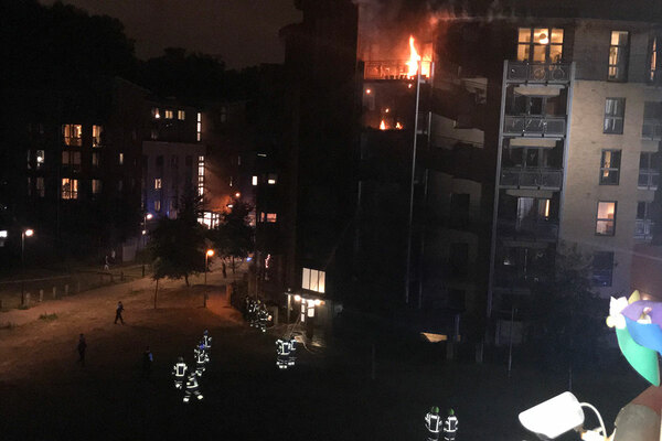 Huge fire in block of flats in east London brought under control by firefighters