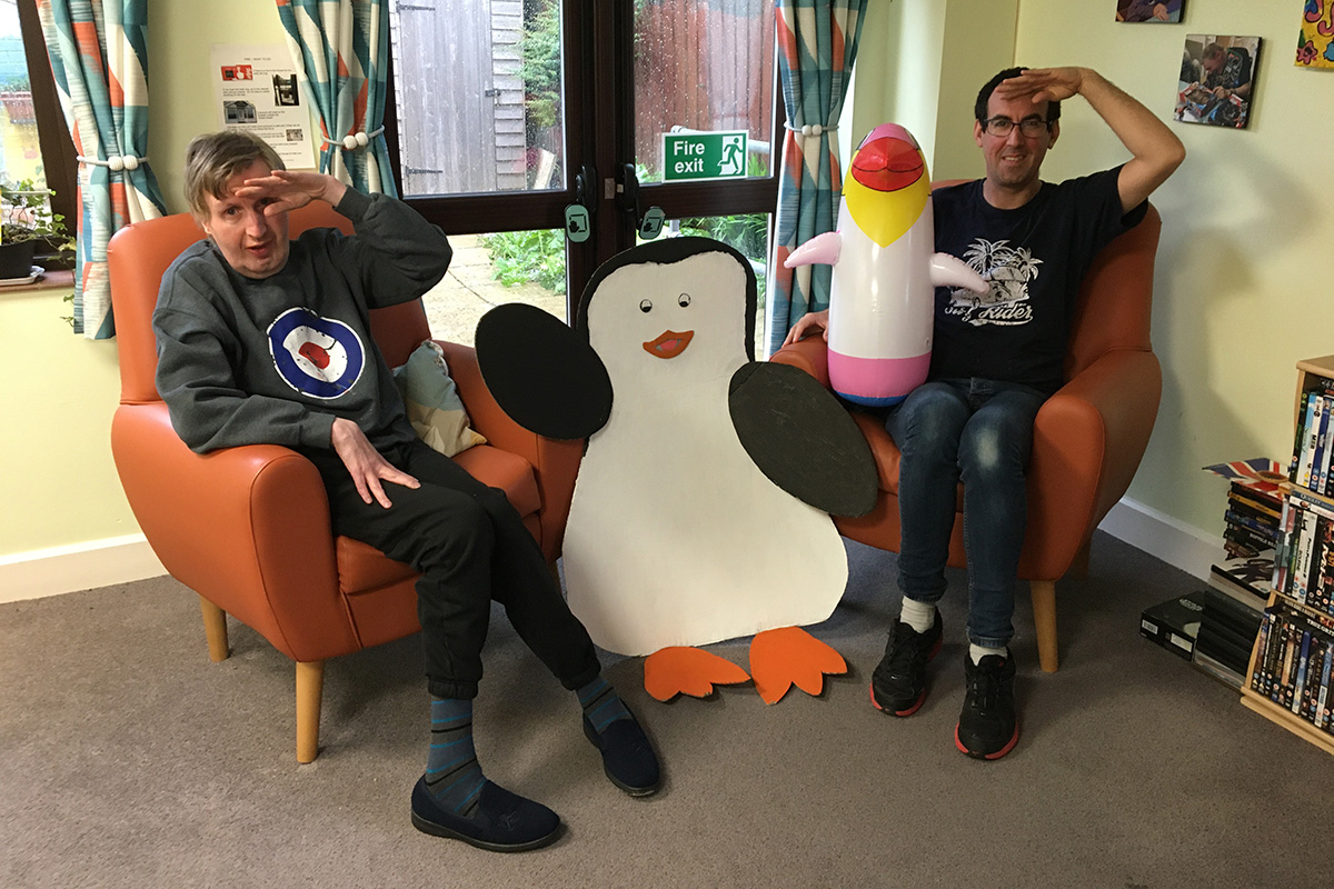 Old Milton Road residents Michael Tidd and Mark Hall pose with a social-distancing penguin