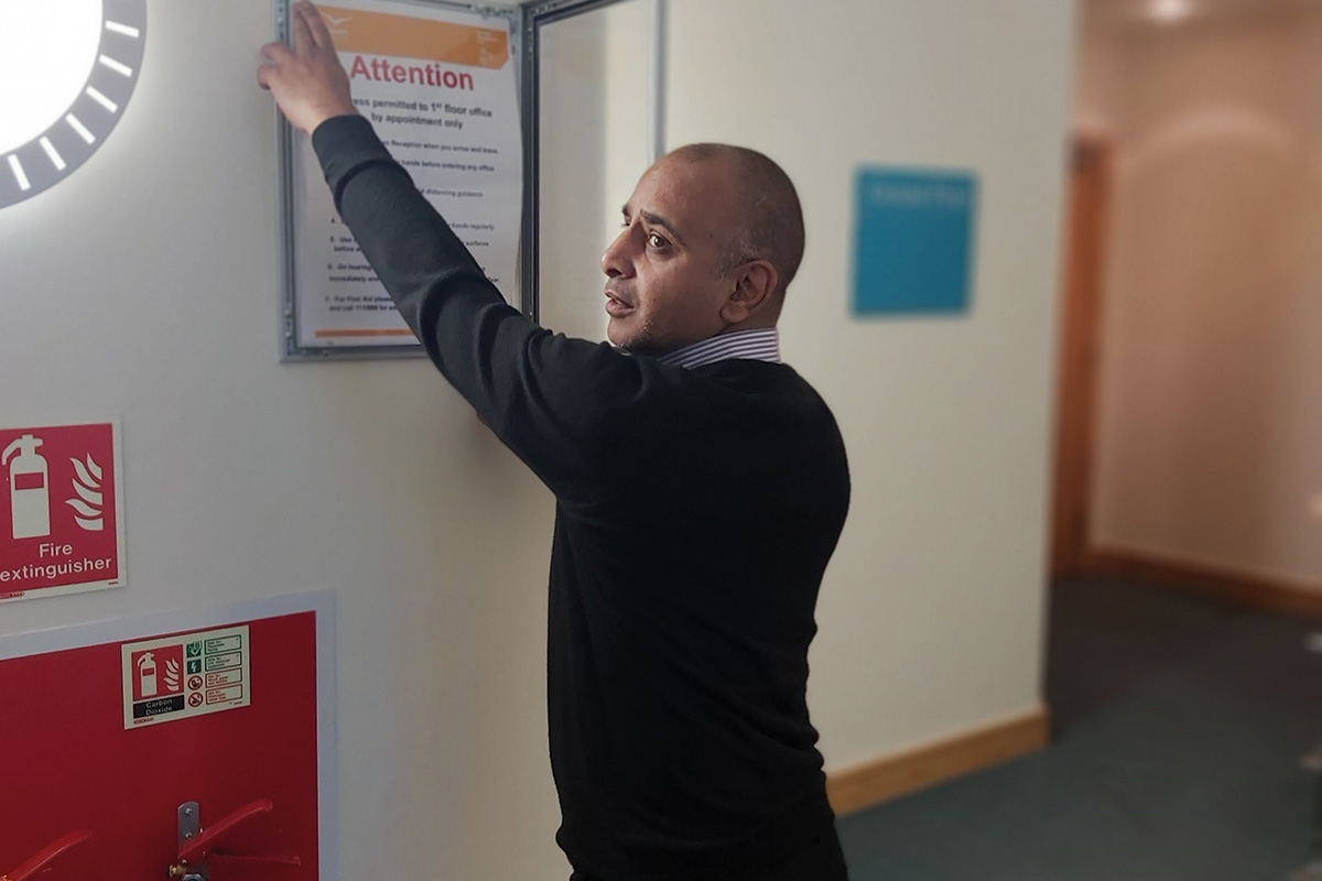 Vishal has had to put up coronavirus signage around the offices