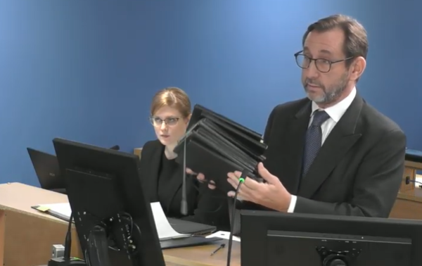 Richard Millett holds up the newly disclosed diaries (picture: Grenfell Tower Inquiry)