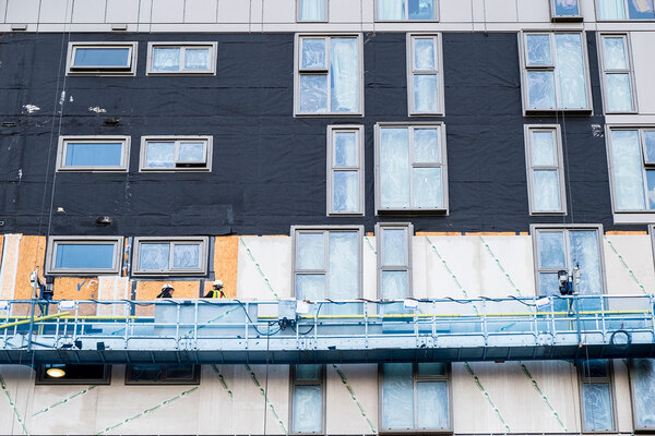 Cladding being removed from a residential block in Nottingham (picture: Alamy)