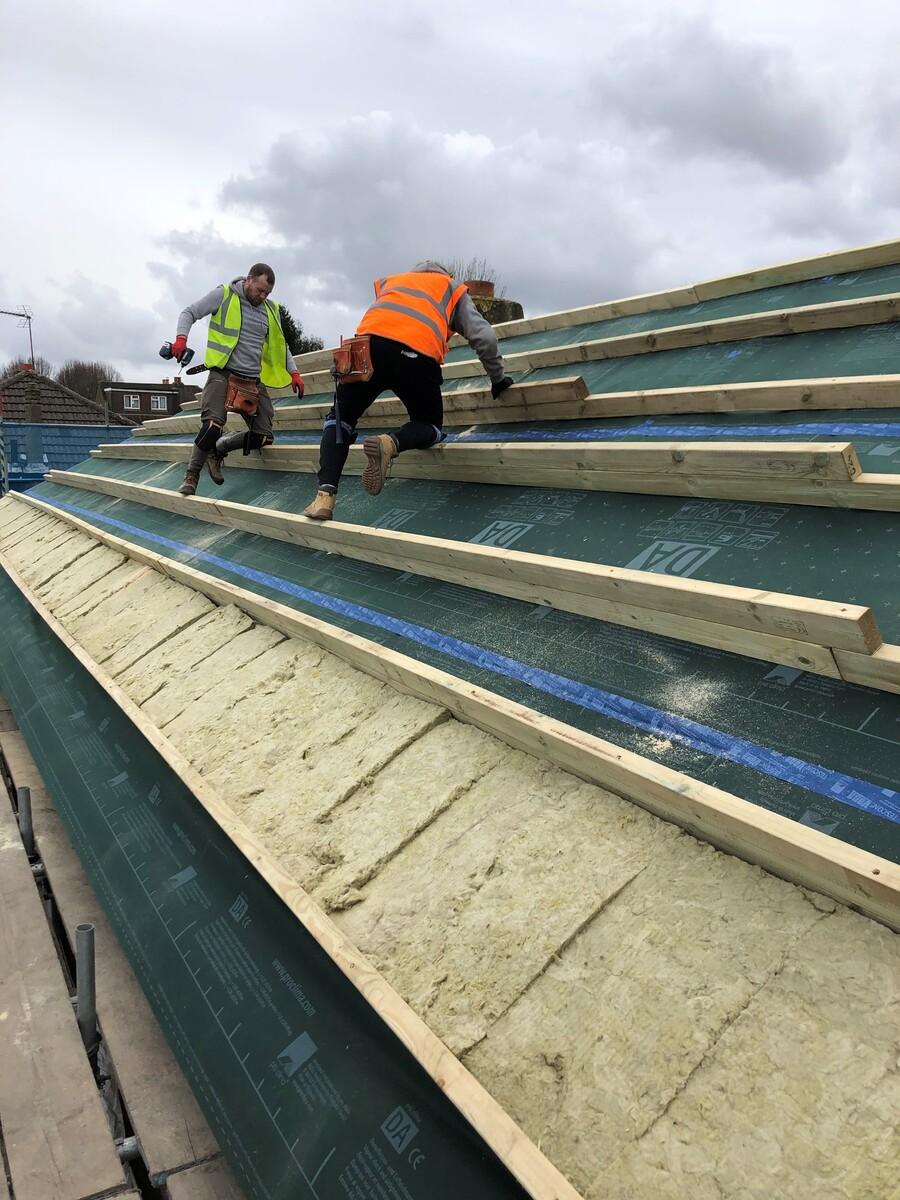 BG Case Study 12 Lloyd roof insulation install rotated.jpg