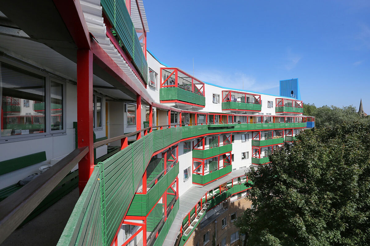 Architect Ralph Erskine designed the Byker Estate to have large windows so that they warm the flats and protect residents from cold winds (picture: Karbon Homes)