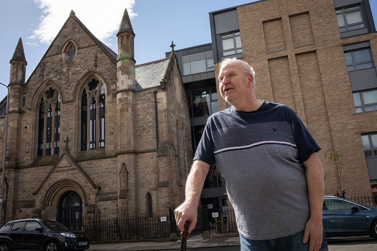 Colin Thomson, outside the housing association home that he lives in, in Shettleston, Glasgow